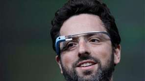 Google co-founder Sergey Brin demonstrates Google's new Glass,