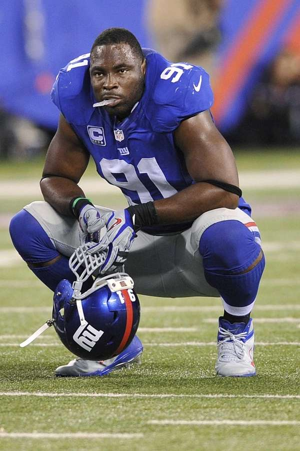 Giants defensive end Justin Tuck reacts during the