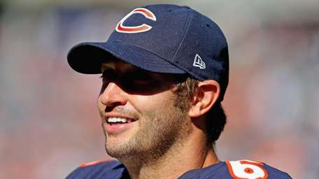 Jay Cutler of the Chicago Bears smiles on