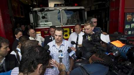David Wright speaks with reporters at Squad 18