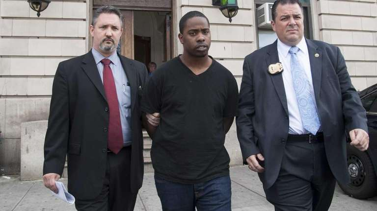 NYPD detectives walk police shooting suspect John Thomas