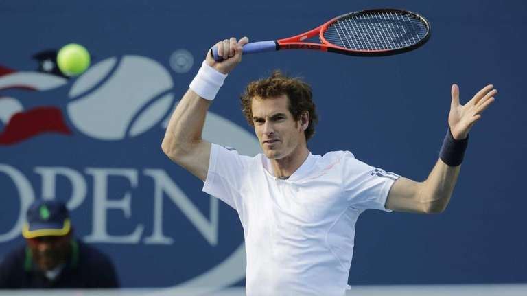 Britain's Andy Murray returns a shot to Serbia's