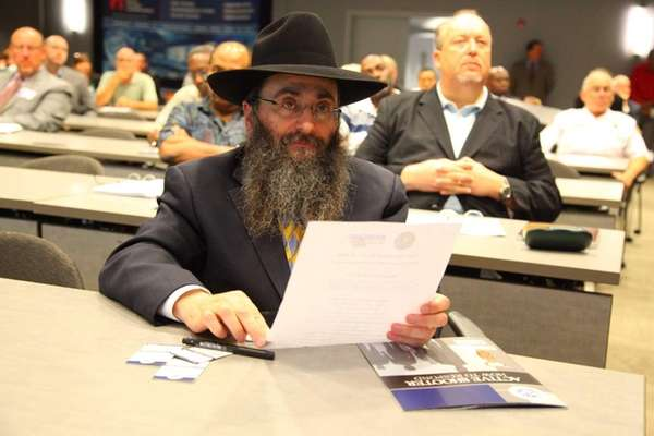 Rabbi Anchelle Perl listens as Congressman Peter King