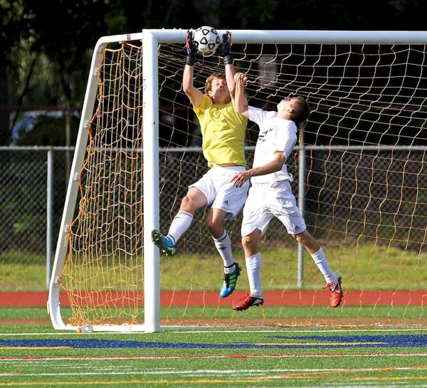 Ward Melville GK Jack Bruckner makes the save