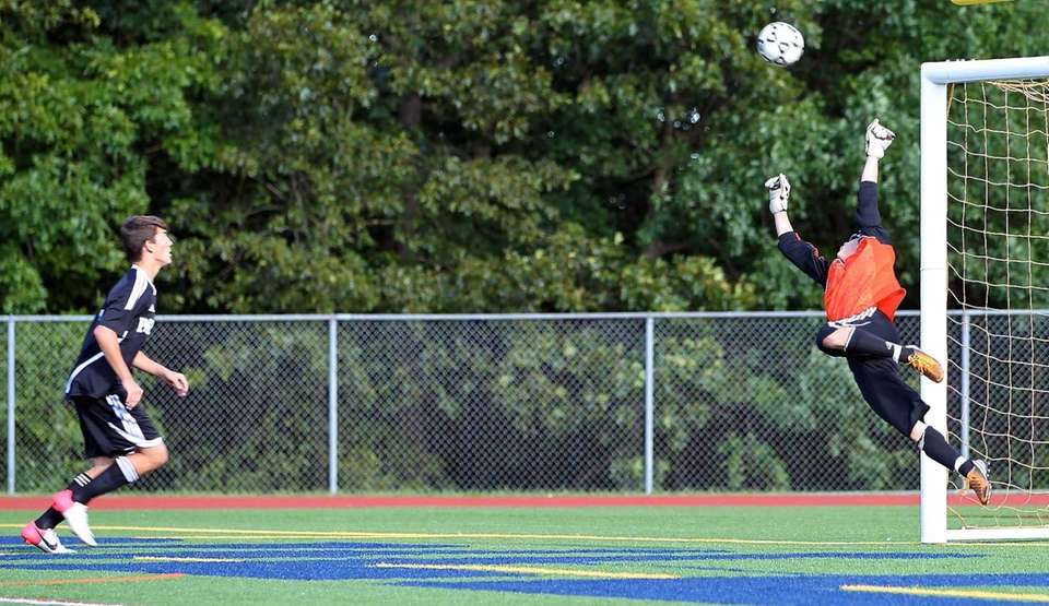 Smithtown West GK Brian Dugan gets a piece