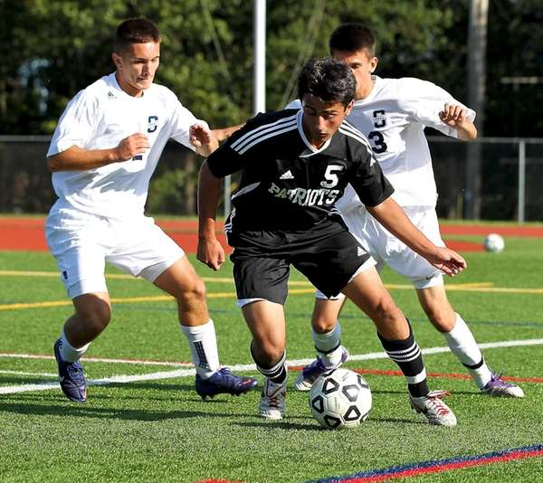 \Ward Melville F Christian Mazzone tries to dribble
