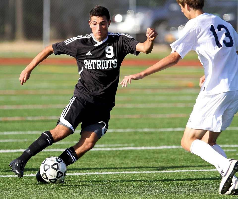 Ward Melville M Anthony Passiatore moves the ball