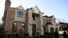 This six-bedroom, 6½-bath brick and stone Colonial in