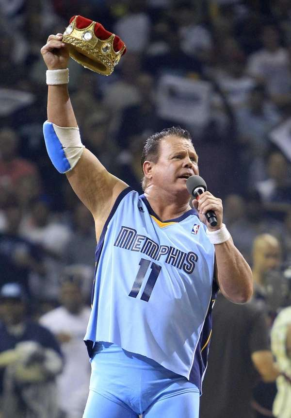 Professional wrestler Jerry Lawler gesturing to fans before