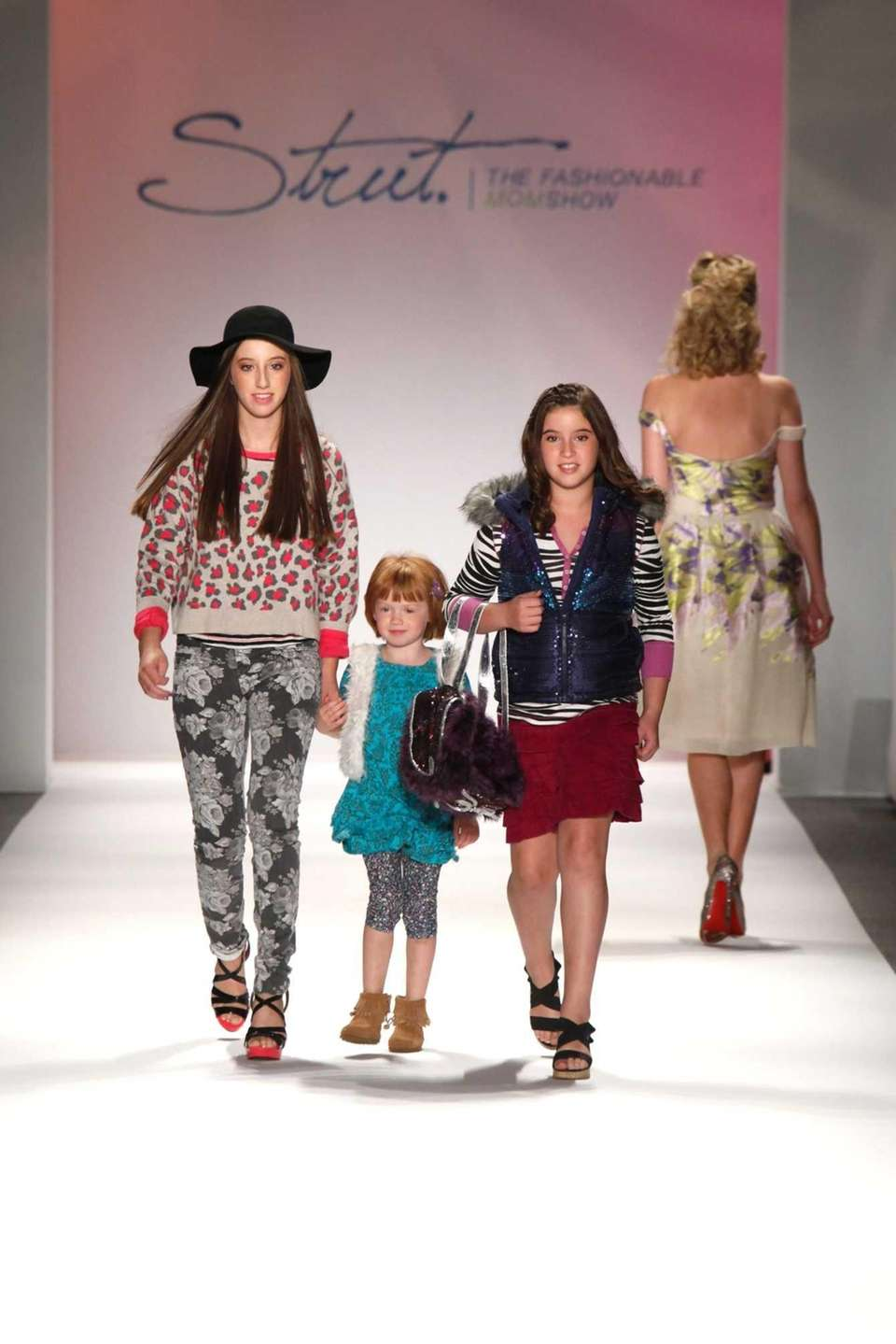 Children walk the runway wearing P.S. From Aeropostale