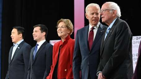 From left, Democratic presidential candidates Andrew Yang, Mayor