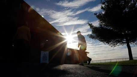 A voter walks to a polling place at