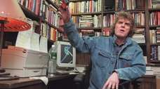 Don Imus removes a wireless microphone following his