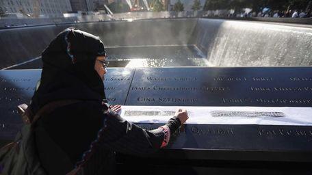 Khudeza Begum etches the name of her slain