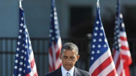 President Barack Obama pauses as he speaks during