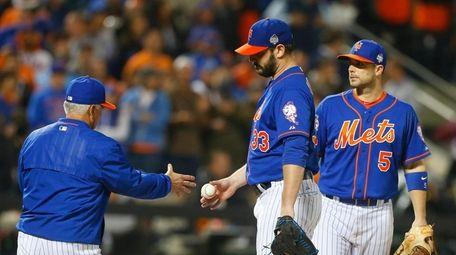 Mets starting pitcher Matt Harvey (33) reacts after