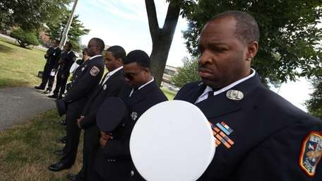 Cpt. Jeff Spencer, right, of the Hempstead Fire