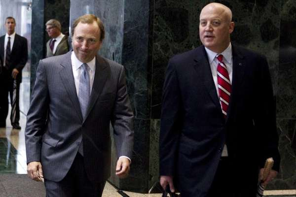 NHL commissioner Gary Bettman, left, and Bill Daly,