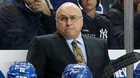 Islanders head coach Barry Trotz looks on in