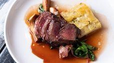 Beef striploin with garlic potato gratin, swiss chard,