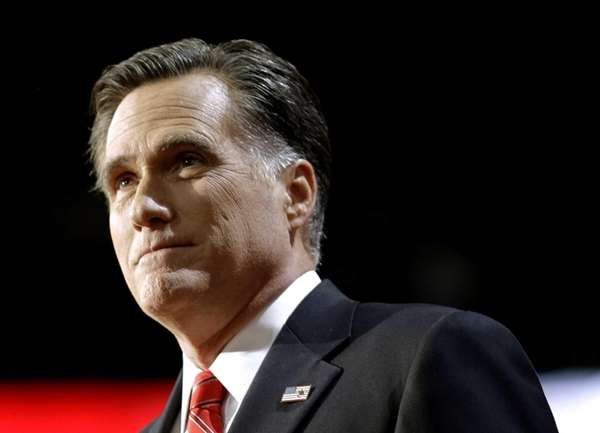Republican presidential candidate Mitt Romney pauses at the