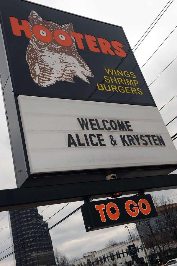 A Hooters sign in Atlanta, Ga. welcomes