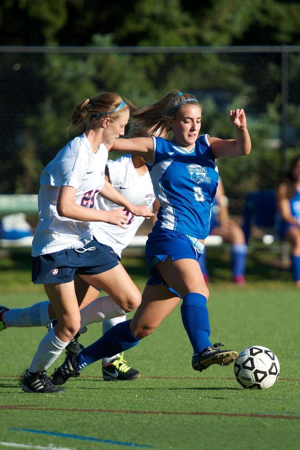 Division's Alexa Schneider dribbles the ball as she