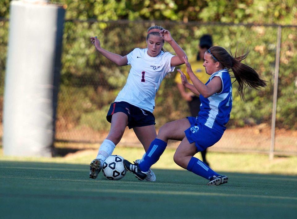 Division's Taylor LeBright slide tackles South Side's Katie