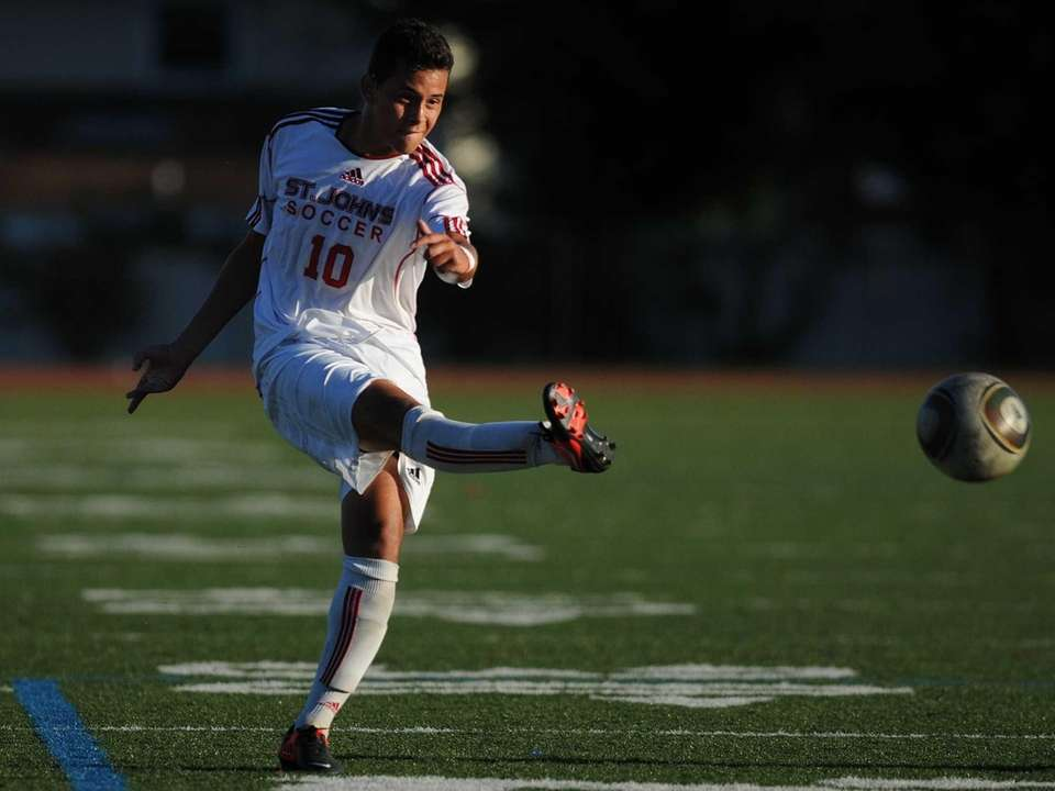 St. John the Baptist's Andres Sandoval boots the