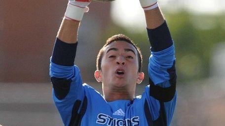 St. John the Baptist goalkeeper Michael Gaffary makes