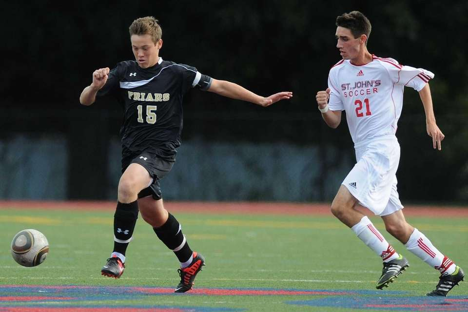 St. Anthony's Mark Jecewiz, left, gets pressured by