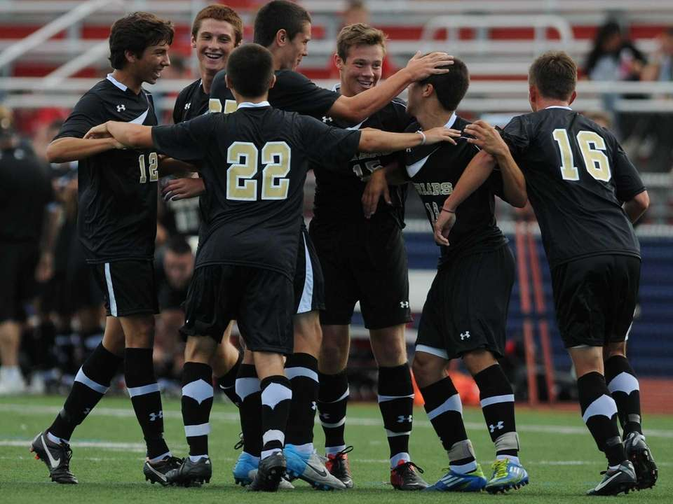 St. Anthony's players celebrate after a goal by