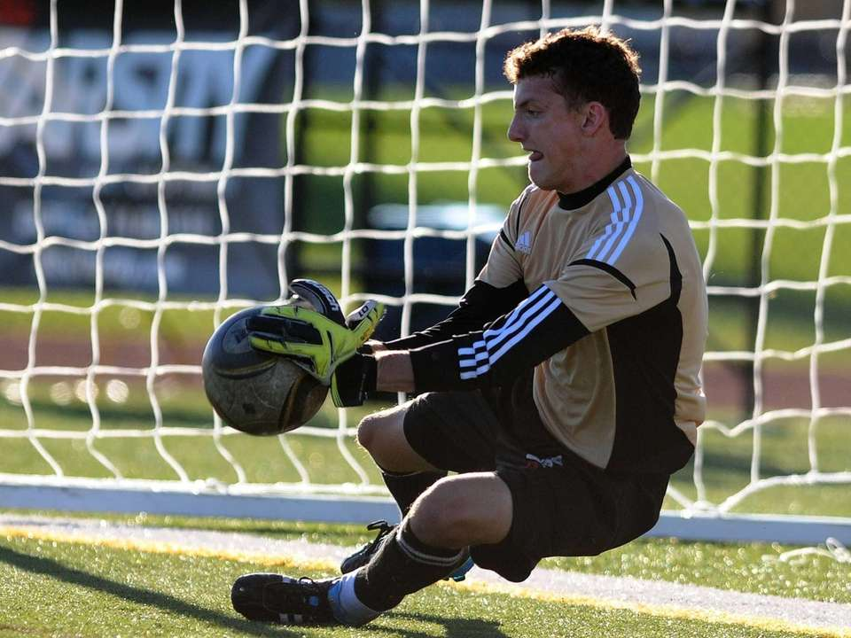 St. Anthony's High School goalkeeper Conor McElhinney makes