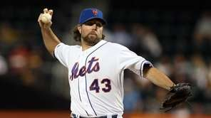 R.A. Dickey delivers a pitch during a game