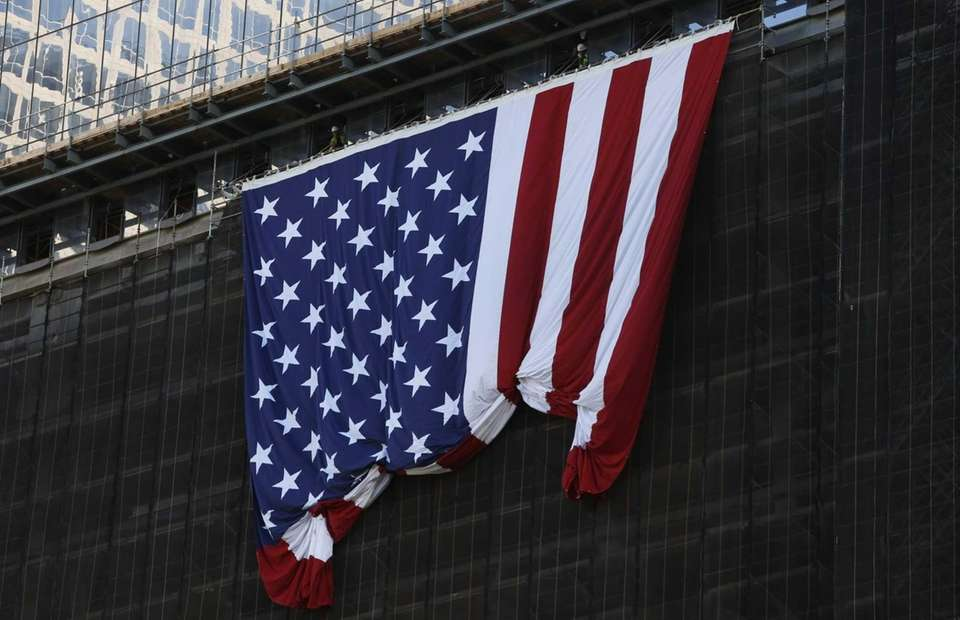 A giant American flag is unfurled from the