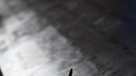 An American flag placed at the name of
