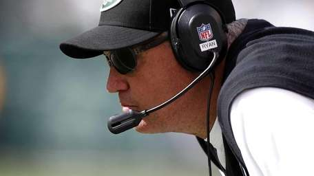 Rex Ryan works on the sidelines during the