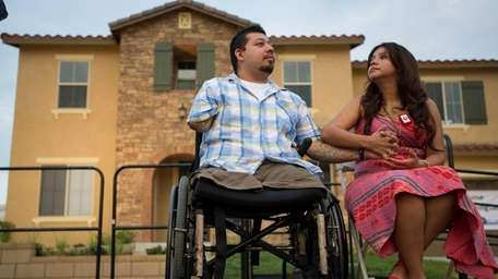 Triple-amputee Marine Cpl. Juan Dominguez and his wife