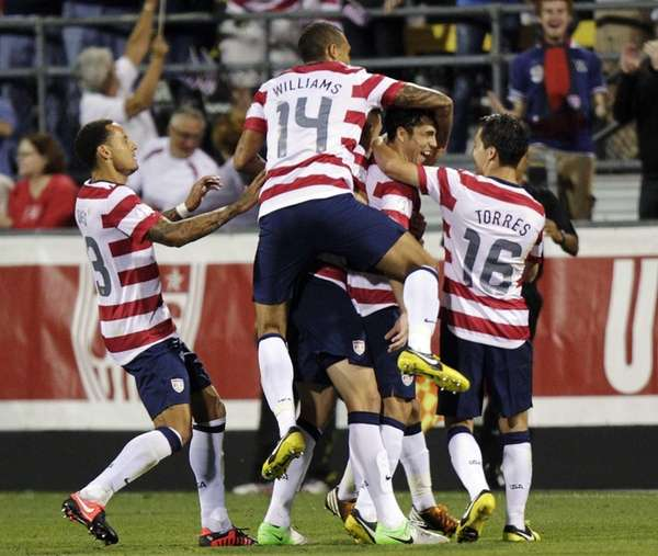 United States players celebrate a goal by Herculez