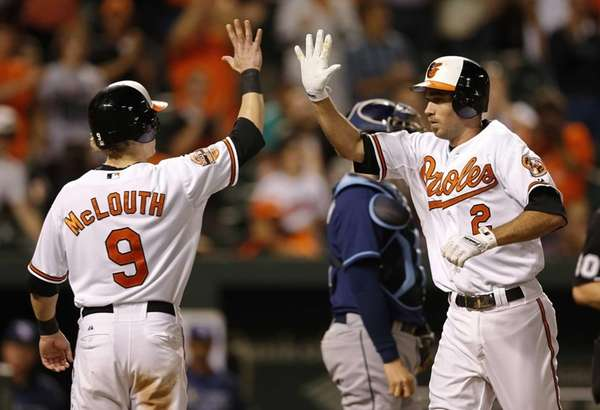 The Baltimore Orioles' J.J. Hardy, right, high-fives teammate