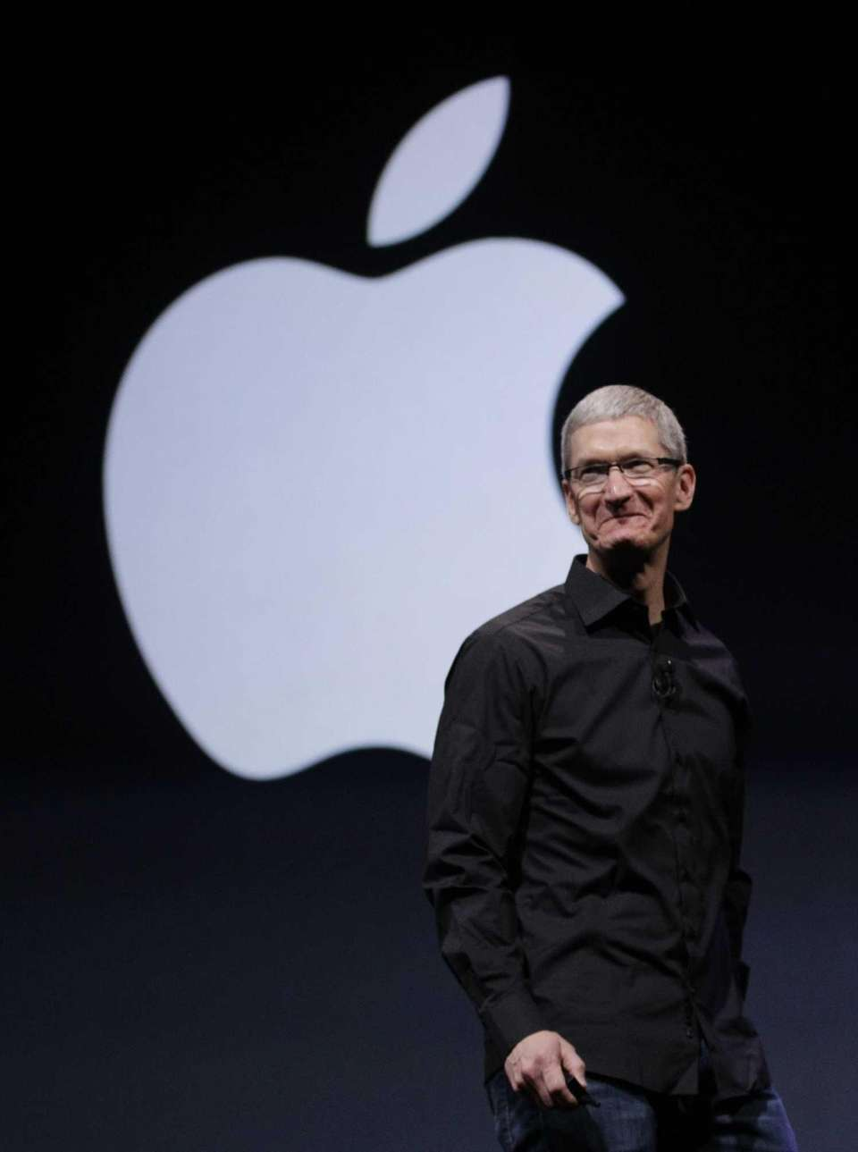 Apple CEO Tim Cook walks on stage at