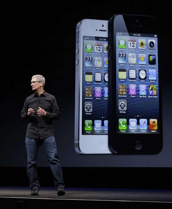 Apple CEO Tim Cook talks on stage during