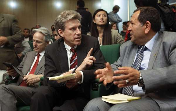 U.S. envoy Chris Stevens, center, at a 2011