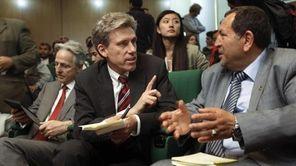 U.S. envoy Chris Stevens, center, at a 2011