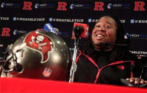 Paralyzed former Rutgers football player Eric LeGrand smiles
