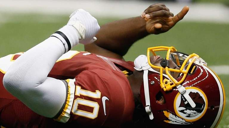 Robert Griffin III celebrates after throwing a touchdown