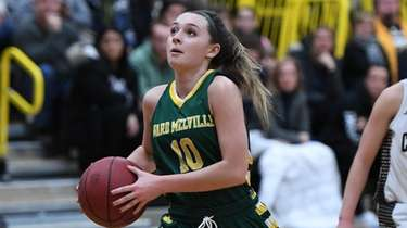 Ward Melville's Jamie Agostino drives to the basket