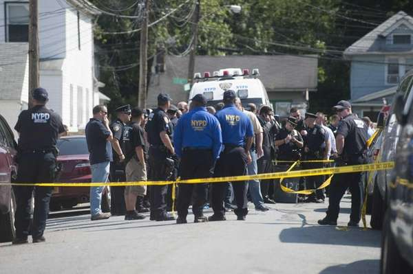 Police conduct an investigation at 170th Street just
