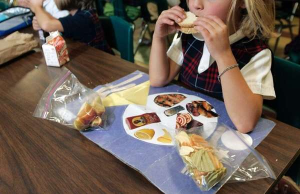 A student uses a place mat that reminds