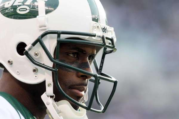 Plaxico Burress looks on during a game against